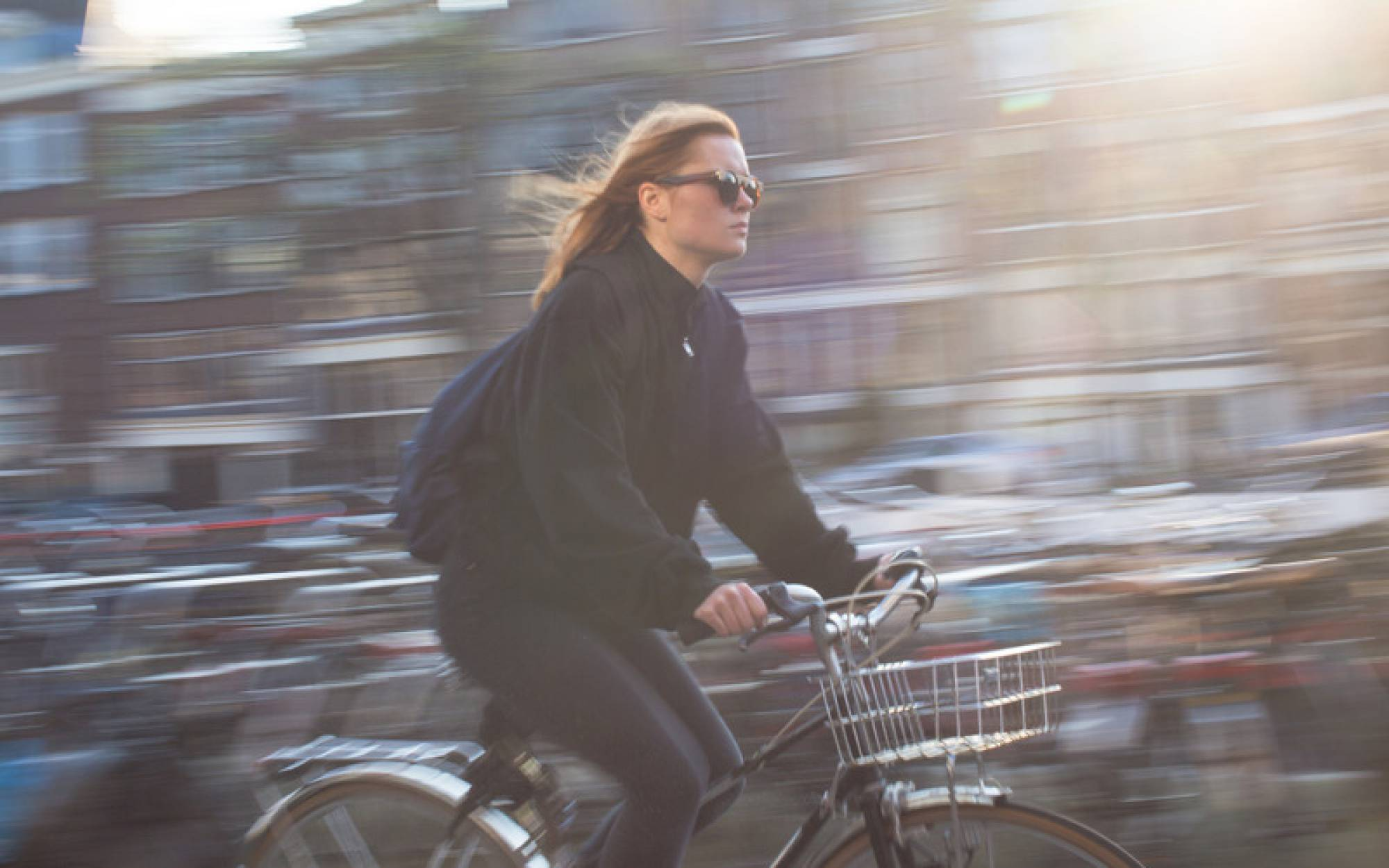 Canva - Woman Riding Bicycle
